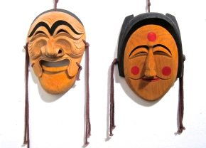 Traditional Korean Hahoe masks, Yang-ban the aristocrat and Bu-ne the flirtatious young woman
